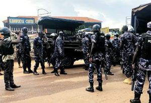 POLICE IN UGANDA FIRE TEAR GAS AT PROTESTERS IN CAPITAL