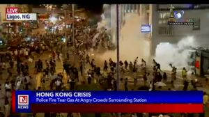 Pro-Democracy Protesters in Hong Kong Fired Tear Gas by Riot Police Men