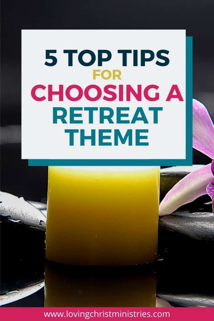 image of yellow candle and purple flower with title text overlay - 5 Top Tips for Choosing a Retreat Theme