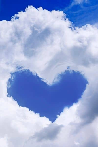image of clouds with a heart shaped opening
