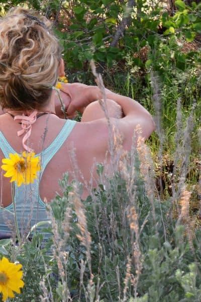 image of women sitting in field of flowers