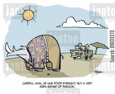on safari cartoon humor: 'Careful man, he has poor eyesight, but a very keen sense of fashion.'
