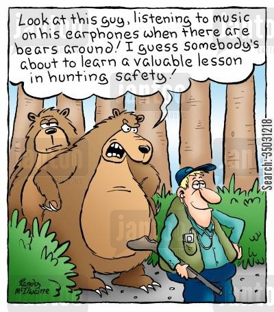 mp3 players cartoon humor: 'Look at this guy, listening to music on his earphones when there are bears around! I guess somebody's about to learn a lesson in hunting safety!'