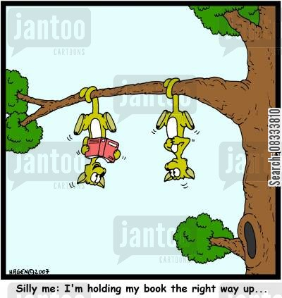 hanging upsidedown cartoon humor: Silly me: I'm holding my book the right way up...