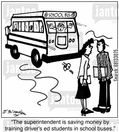 school administrators cartoon humor:  'The superintendent is saving money by training driver's ed students in school buses.'