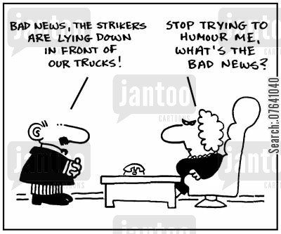 strike action cartoon humor: 'Bad new, the strikers are lying down in front of our trucks.'