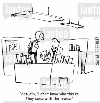 office jobs cartoon humor: 'Actually, I don't know who this is. They came with the frame.'