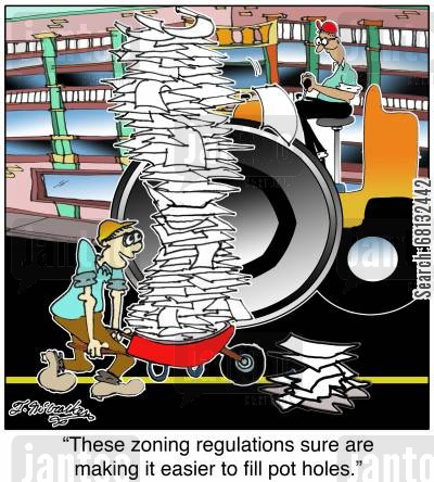 government regulations cartoon humor: 'These zoning regulations sure are making it easier to fill pot holes.'
