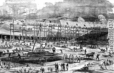 ironclad cartoon humor: The 'Dunderburg' (then Largest Warship in the World) in William H Webb's Shipyard