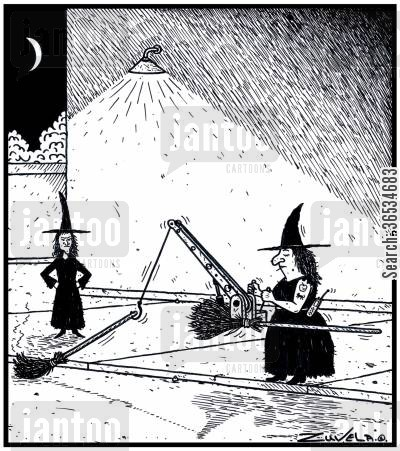 magics cartoon humor: A Witch's broom has broken down and is being towed away.