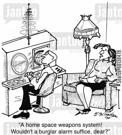 security systems cartoon humor: 'A home space weapons system? Wouldn't a burglar alarm suffice, dear?'