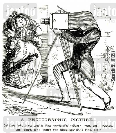 modernity cartoon humor: Woman mistakes a camera for a gun