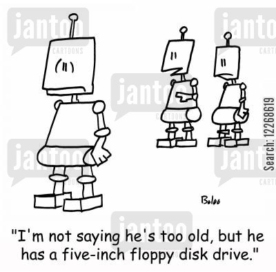 retirement ages cartoon humor: 'I'm not saying he's too old, but he has a five-inch floppy disk drive.'