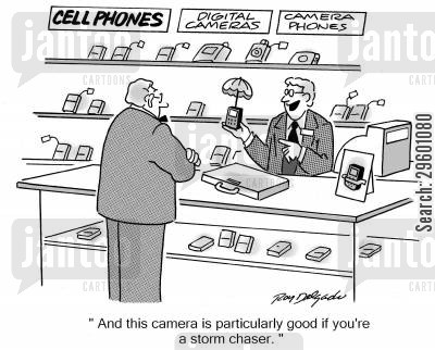 phone salesmen cartoon humor: 'This camera is particularly good if you're a storm chaser.'