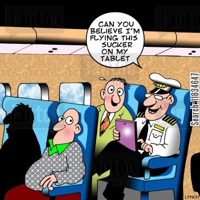 tablet computers cartoon humor: 'Can you believe I'm flying this sucker on my tablet.'
