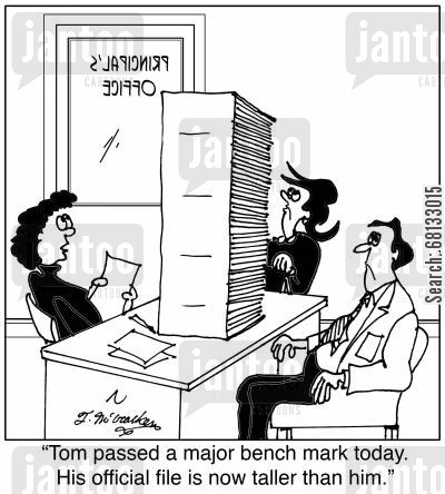 educational standards cartoon humor:  'Tom passed a major bench mark today. His official file is now taller than him.'