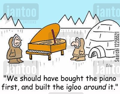 grand pianos cartoon humor: 'We should have bought the piano first, and built the igloo around it.'