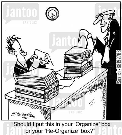 in boxes cartoon humor: 'Should I put this in your 'Organize' box or your 'Re-Organize' box?'