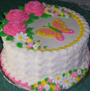 Place a design on a frosted cake.