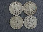 Lot: 2450 - (4) 1942-1945 WALKING LIBERTY HALVES