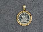Lot: 2468 - 14K BEZEL PENDANT WITH PLATINUM COIN