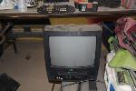 Lot: 034&035 - 14-INCH TV W/VCR & BISSELL VACUUM CLEANER