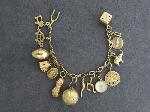 Lot: 2932 - CHARM BRACELET WITH 14K CHARMS
