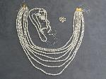 Lot: 3150 - SEVEN STRAND PEARL LIKE NECKLACE W/18K CLASP