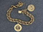 Lot: 3572 - BRACELET WITH 2 CHARMS