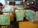 Lot: 68.UV - (2) BOXES AND 1 BAG OF GREEN GRADUATION GOWNS AND MORTAR BOARD HATS