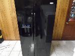 Lot: A6624 - Working Whirlpool Gloss Black Refrigerator