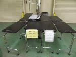Lot: 72.HOU - (8) BLACK LAMINATE ROLLING MANICURE TABLES. (2) GRAY MOTTLED LAMINATE MANICURE TABLES. (7) BLACK ROLLING STOOLS.