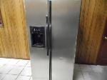 Lot: A6703 - Working GE Stainless Steel Refrigerator