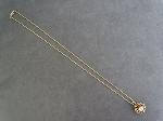 Lot: 4854 - 14K NECKLACE WITH 14K PENDANT