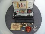 Lot: 5304 - SILVER BEADS, FOREIGN CURRENCY & GUN CLEANING KIT