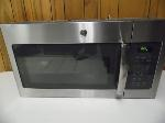 Lot: A7324 - Working GE Over Range Stainless Microwave