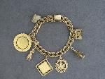 Lot: 6629 - CHARM BRACELET WITH 10K & 14K CHARMS