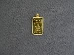 Lot: 6633 - 18K BEZEL WITH .9999 GOLD CHARM CREDIT SUISSE