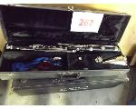 Lot: 262 - (3) Bass Clarinets with case