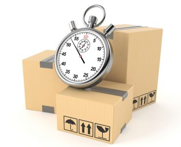 A clock placed on shipping packages
