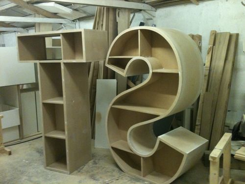 Letter bookcases by bally for Letter shaped shelves