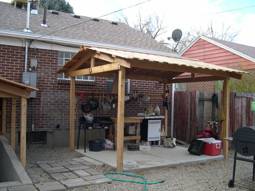 My outdoor kitchen with a different roof structure by for Outdoor kitchen roof structures