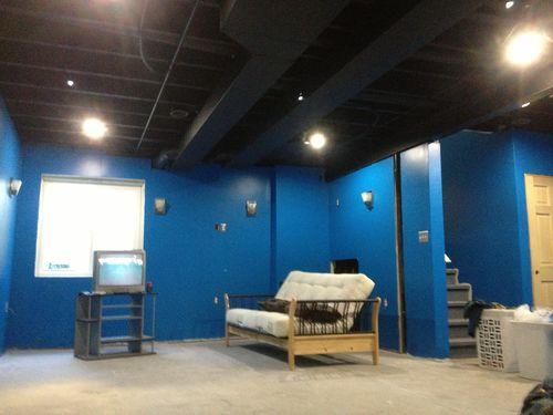 Basement bar and wanescotting by pkff for Black ceiling basement ideas