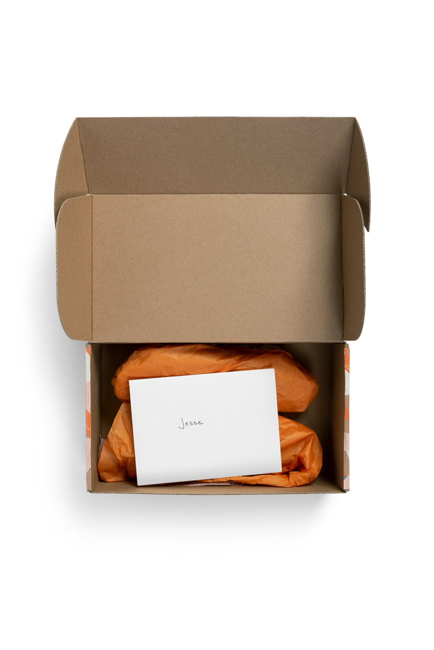 Custom roll end tuck front corrugated mailer box with roll end base, tuck front lid, cherry locks, dust flaps. Flexography on natural kraft liner.