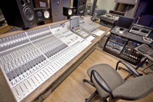 Jeffrey Linn, an LVC audio and music production graduate, sits at his sound boards