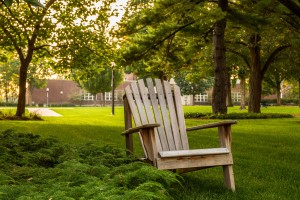 An adirondack chair sits on the quad