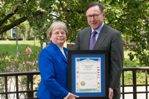 Dr. Elizabeth Bains receives an award from President Thayne