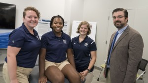 Dr. Joe Murphy poses with students in our athletic training program