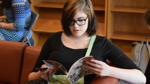 A Lebanon Valley College student flips through a Green Blotter issue at its release party