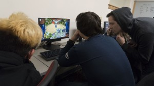 Teammates collaborate during esports practice